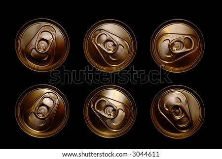 golden aluminum drink cans piled - stock photo