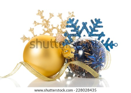 Golden and blue christmas ornaments on white background with space for text - stock photo