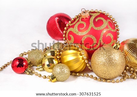 Golden and red Christmas decorations on a white background  - stock photo