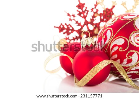 Golden and red christmas ornaments on white background. Merry christmas card. Winter holidays. Xmas theme. - stock photo
