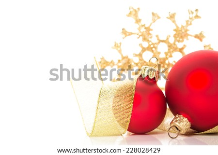 Golden and red christmas ornaments on white background with space for text - stock photo