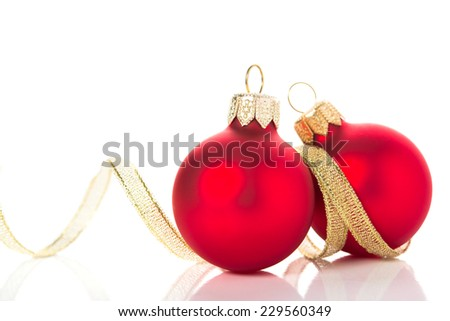 Golden and red christmas ornaments on white background with space for text. Winter holidays. Xmas theme. - stock photo