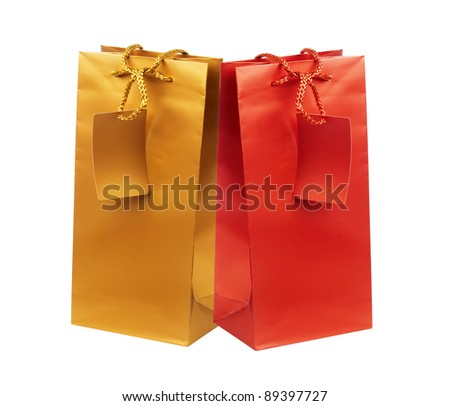 Golden and red gift shopping bags isolated on white