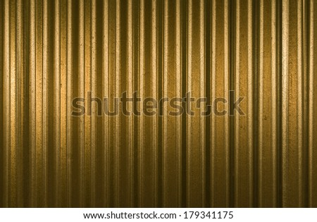 Golden and shiny striped steel background - stock photo