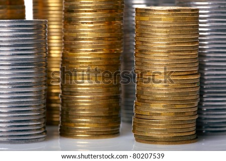 Golden and silver coin stacks
