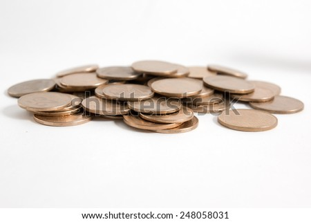 Golden and silver columns of coins isolated on white background