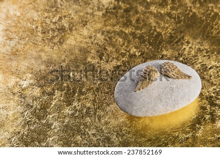 Golden angel wings for a death or sad background or for a condolence card. - stock photo