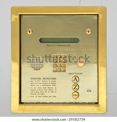 Golden apartment building security keypad for access - stock photo
