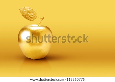 Golden apple on yellow background. - stock photo