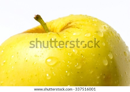 Golden Apple with Water Droplets - Close Up
