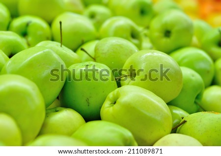 Golden apples close up in market.  - stock photo