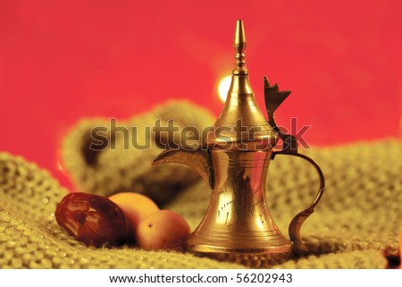 golden arabic tea pot with dates - stock photo