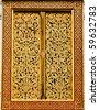 Golden Art on the temple window - stock photo