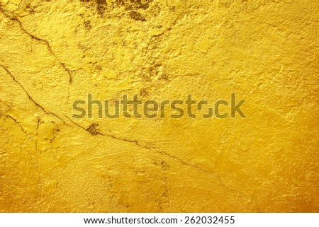 Golden background old surface cracking. - stock photo