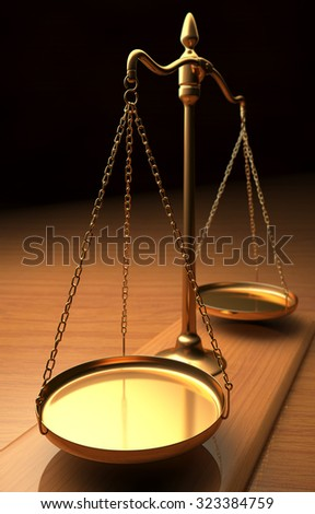 Golden balance with depth of field and focus on the center of the first tray. - stock photo