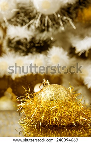 golden ball at the front Christmas decoration,Christmas tree at background warm cast  - stock photo