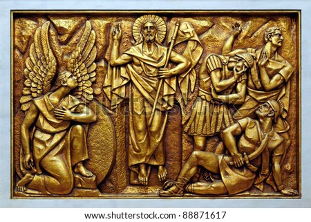 Golden bas-relief of the Basilica of Fatima representing one of the fourteen mysteries of the rosary (similar to the stations of the cross). This one represents the resurrection of Jesus - stock photo