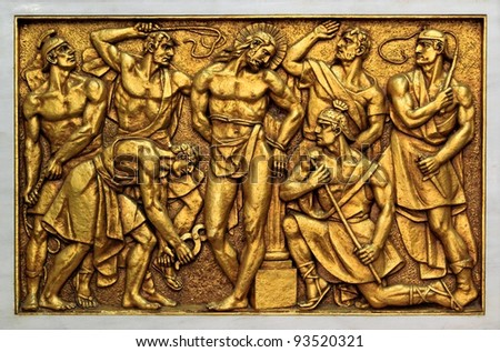 Golden bas-relief of the old Basilica of Fatima representing one of the fourteen mysteries of the rosary, similar to the stations of the cross - stock photo