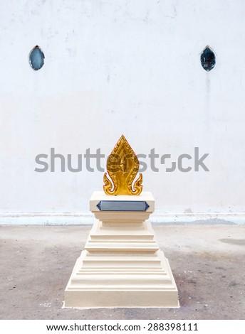 Golden battlements sculpture around the countryside Thai temple. - stock photo