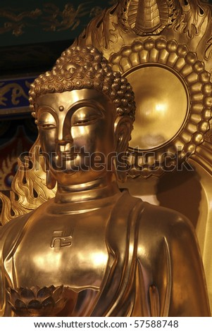 Golden Beautiful Buddha statue close-up in Chinese temple