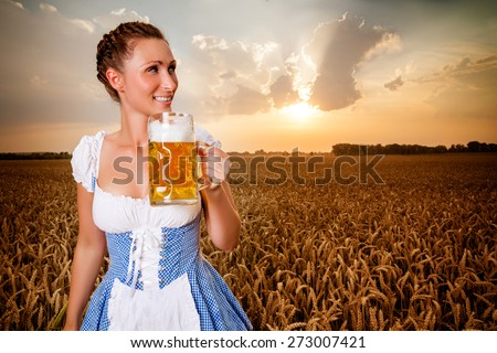 golden beer festival holding jar - stock photo