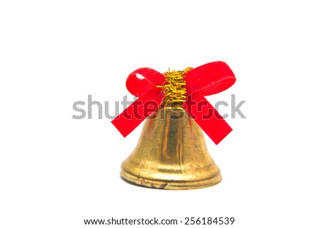 golden bell with red ribbon on white background - stock photo