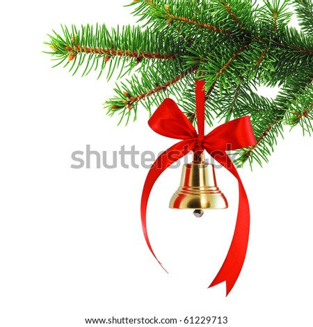 Golden bell with red satin ribbon bow hanging on a green spruce branch - stock photo