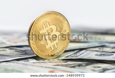 golden bitcoin coin on dollars close up. Cryptocurrency