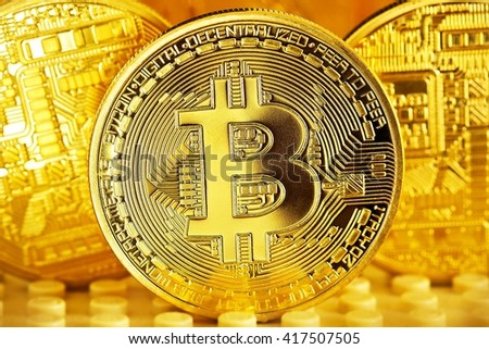 Golden Bitcoins close-up on a gold background .Photo (new virtual money ) - stock photo