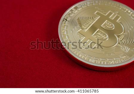 Golden Bitcoins (digital virtual money) on red background. - stock photo