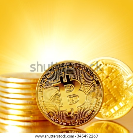 Golden Bitcoins on a gold background .Photo (new virtual money ) Background with a copy-space . - stock photo