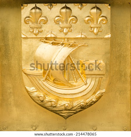 Golden Blazon of Paris, coat of arms, with sailboat on the wave and flowers of lily, France - stock photo