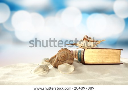 golden book and shells