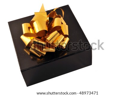 golden bow on a black box isolated on white background