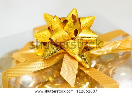 golden bow on a gift box. Close-up
