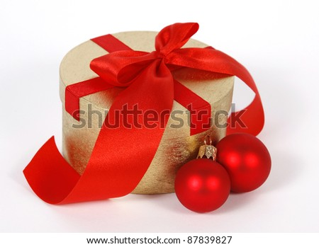 Golden box decorated with the red ribbon