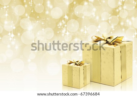 Golden boxes with bow against bokeh background