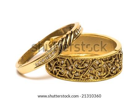 golden bracelets isolated on white background - stock photo