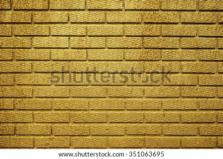 Golden brick wall for text and background - stock photo