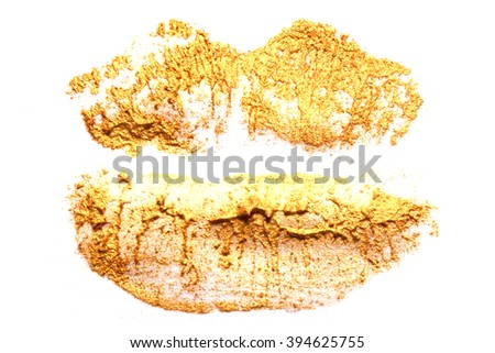 Golden bronze lipstick on natural closeup. - stock photo