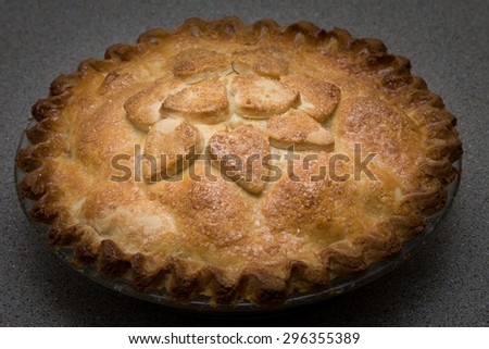 Golden brown home made baked apple pie - stock photo