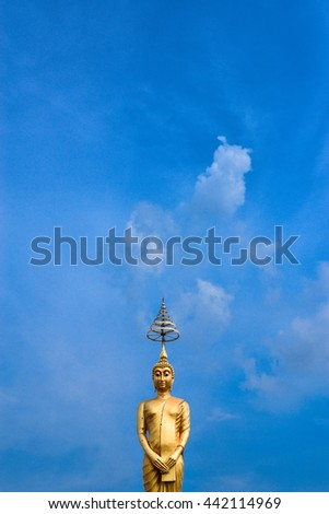 Golden Buddha and  blue sky