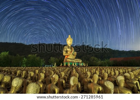 Golden Buddha at Buddha Memorial park  and star tails. - stock photo