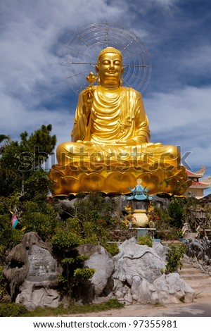 Golden Buddha holding the golden lotus. - stock photo