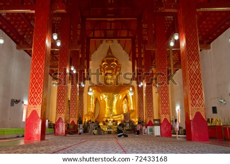 Golden Buddha image in temple - stock photo
