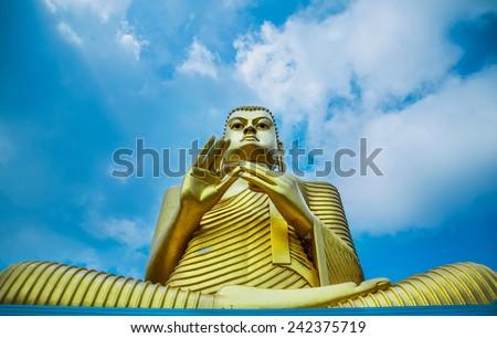 Golden Buddha  in Dambulla, Sri Lanka.   - stock photo