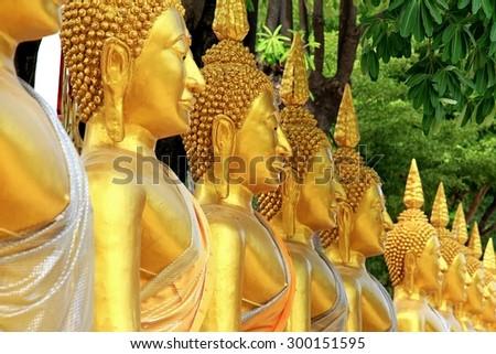 Golden buddha in temple, Row of Golden Buddha in Thailand. Buddha statue. - stock photo