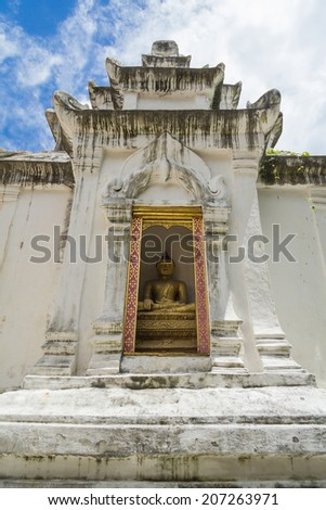 Golden Buddha in Thailand temple walls white. - stock photo