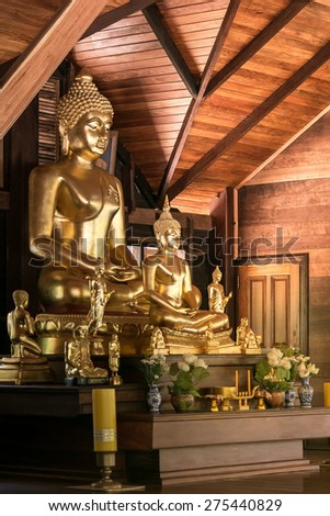 Golden Buddha in wood cottage. - stock photo