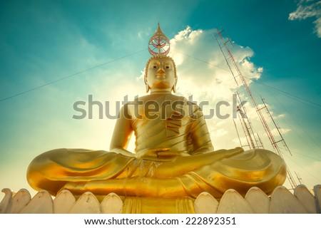 Golden buddha on blue sky, Thailand - stock photo
